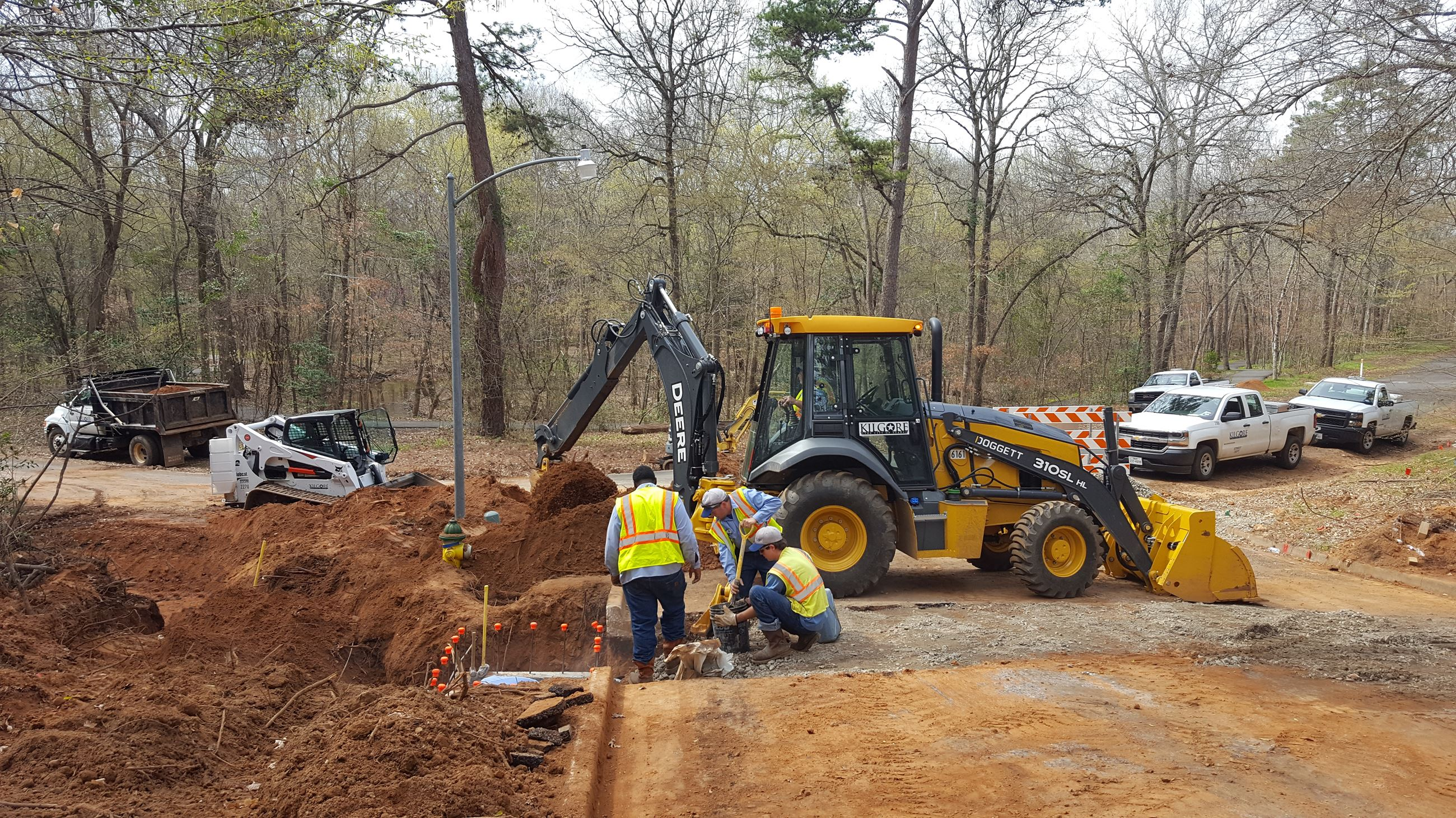 Photo of Streets & Drainage Crew installing a new storm inlet.