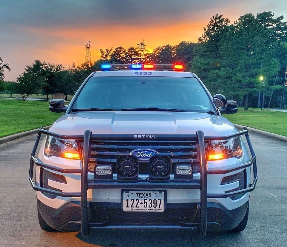 Front of patrol car with sunset in background