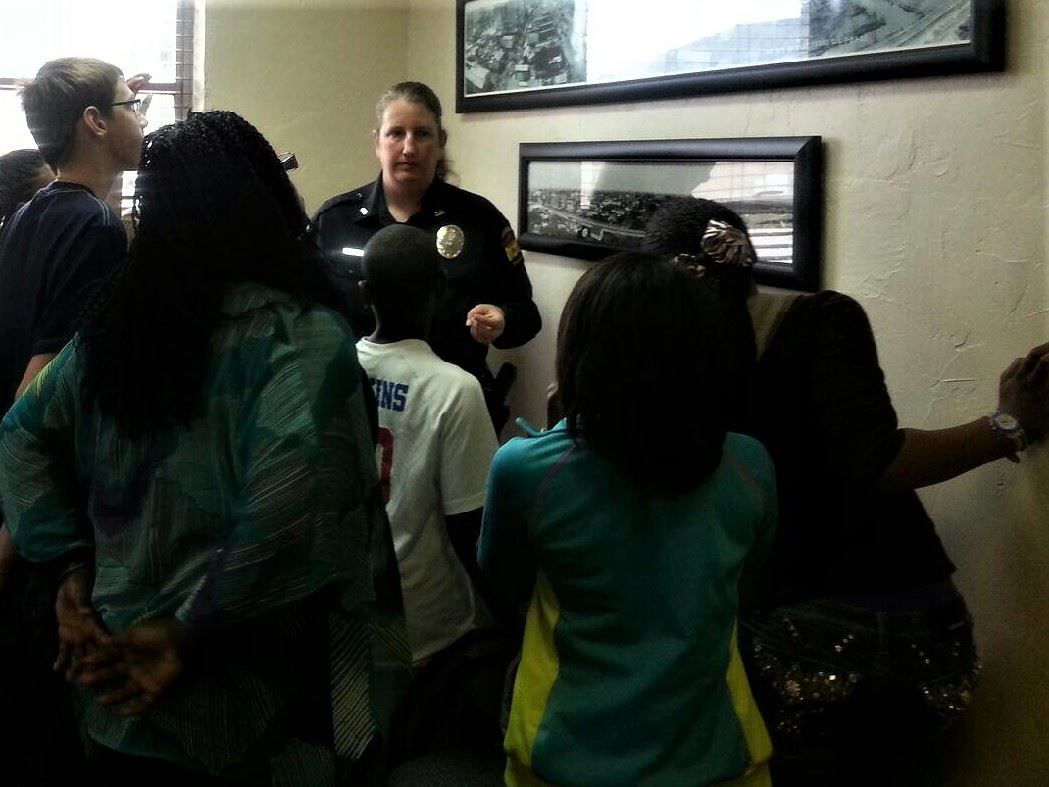 Officer giving tour to group of children