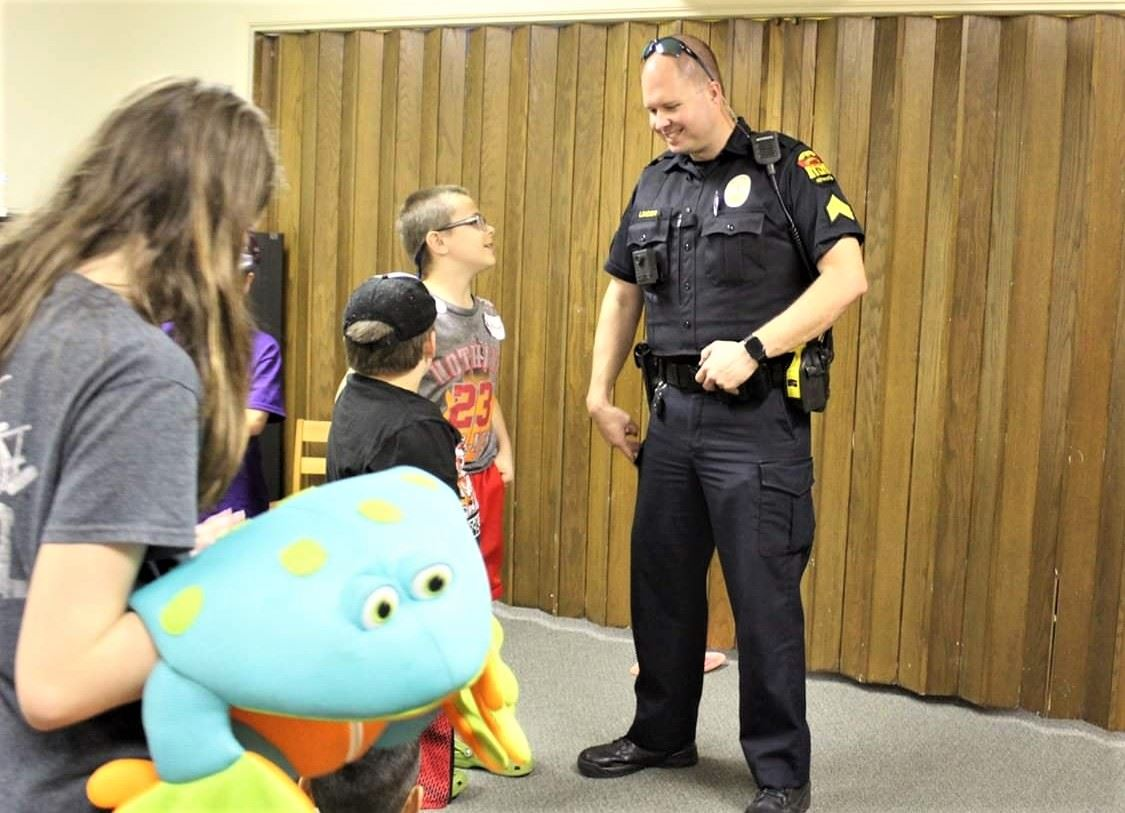 Officer speaking to group of children at Vacation Bible School