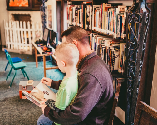 Library father reading to son