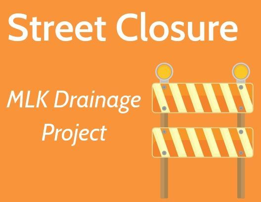 Street Closure MLK Drainage Project with image of a street barricade