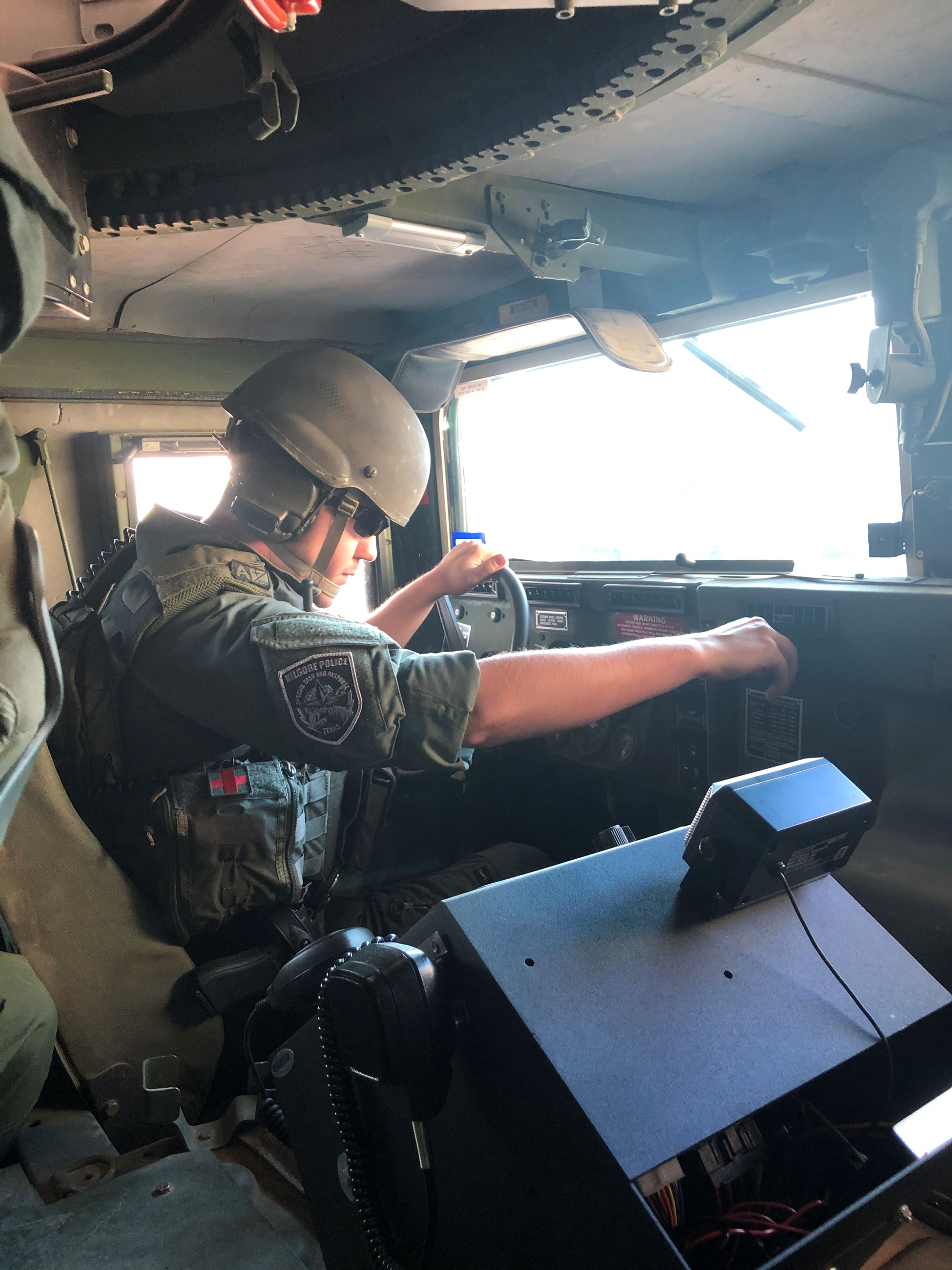 Cpl Sims driving the special operations and rescue humvee