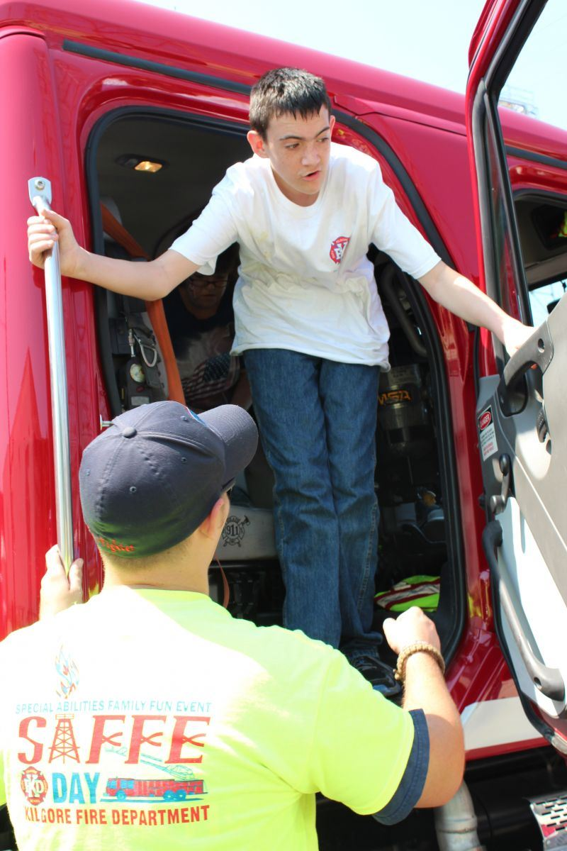 Young Man Exiting the Cab of a Firetruck