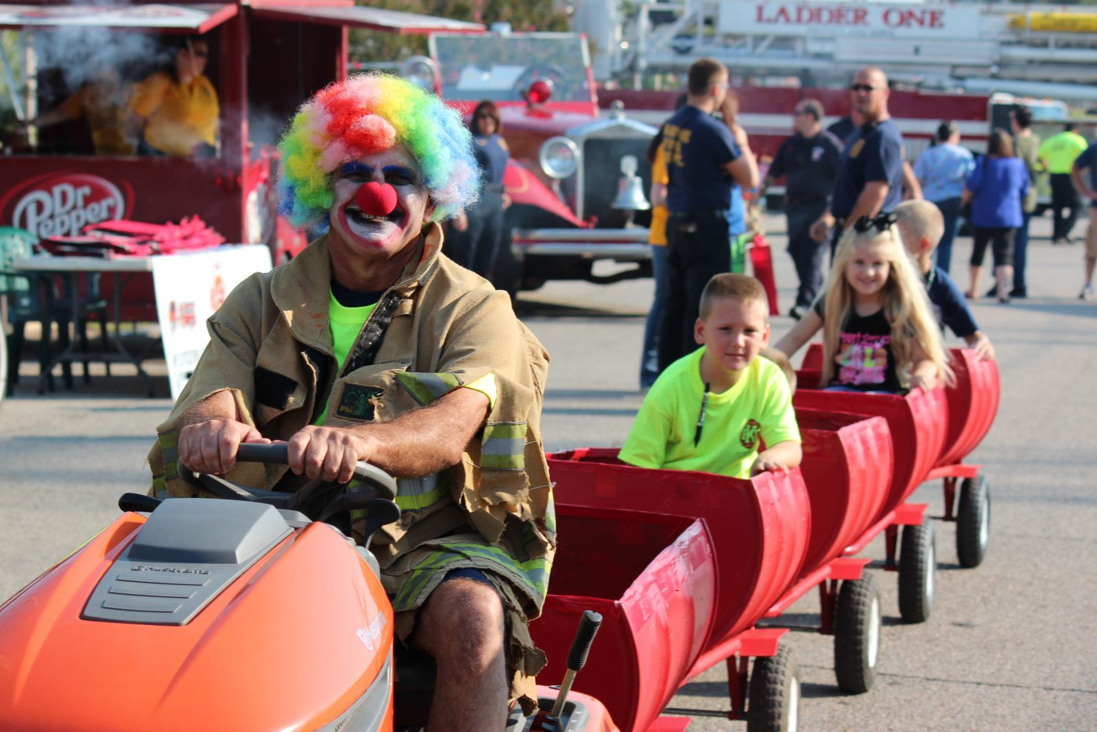 Man Dressed as a Clown Driving a Train Around the Fairgrounds