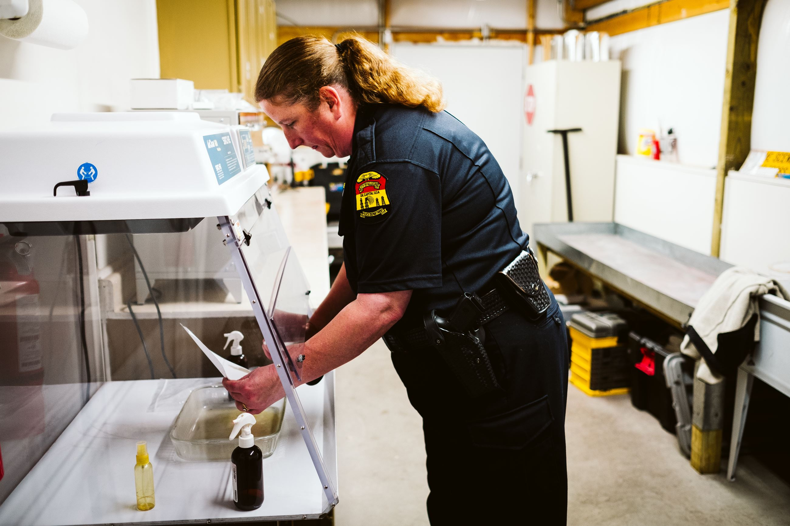 Investigator analyzing evidence in crime lab